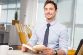Call center operator holding book — Stock Photo