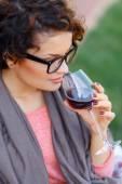 Pleasant girl drinking wine — Stock Photo