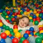 Happy girl in ball pool — Stock Photo #65932429