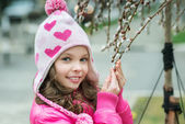 Girl with a branch of willow — Stock Photo