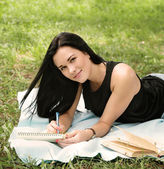 Student studying in park — Stock Photo
