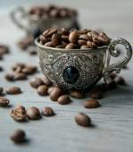 Coffee beans in  vintage cups — Stock Photo