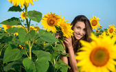 Young woman with sunflowers — Stock Photo