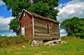 Crumbling foundation of granary — Stock Photo