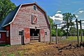 Manure carrier in back of barn — Stock Photo