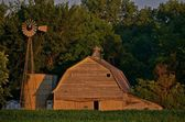 Old farm building reflected in the morning sunrise — Stock Photo