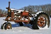 Old rusty tractor in the snow — Stock Photo