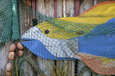 Artsy fish head on on old weathered wall — Stock Photo