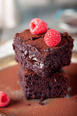 Brownies with raspberry on a wooden background. — Stok fotoğraf