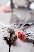 Old vintage cutlery bound with a rope, dried rose — Stok fotoğraf