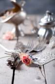 Cutlery bound with with dried roses — Stock Photo