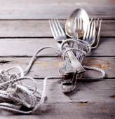 Vintage cutlery, spoon and forks roped — Stock Photo
