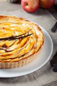 French apple tart with vanilla pod — Stock Photo