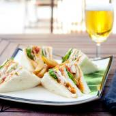 Club sandwich and a beer — Stock Photo