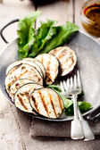 Grilled eggplants with salad leaves — Stock Photo