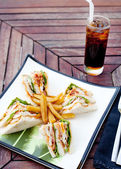 Club sandwich with iced soda drink — Stock Photo