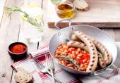 Grilled sausages with beans — Stock Photo
