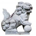 Chinese stone lion with globe isolated on white. — Stock Photo #60128027