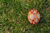 Traditional hand made easter eggs in the grass — Stock Photo
