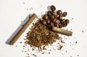 Broken cigarette tobacco rashes and roasted coffee beans on a white background — Stock Photo