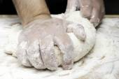 Kneading bread with hands — Stock Photo