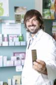 Pharmacist and the medicament — Stock Photo