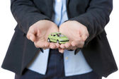 Bussines woman and miniature car — Stock Photo