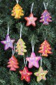 Christmas tree ornaments - trees and stars — Stock Photo
