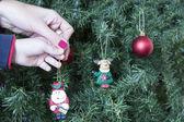 Decorate Christmas tree — Stock Photo