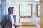 Woman entering into an optician store — Stock Photo
