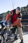 Man caressing a motorcycl — Stock Photo