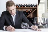 Winemaker examining a wine glas — Fotografia Stock