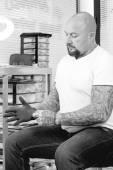 Tattoo artist putting on the glove — Stock Photo