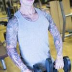 Man making front raises - workout routine — Stock Photo #66365839