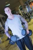 Man making lateral raises - workout routine — Stock Photo