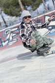 Male skater skating crouched — Stock Photo