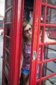 People in London- woman by red phone booth. — Stock Photo