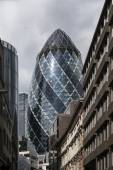 LONDON, UK - AUG 16: The Gherkin Tower (30 St Mary Axe) in the City of London on August 16, 2014.The skyscraper was designed by Norman Foster and Arup Group and it was erected by Skanska. — Stock Photo