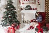 Girl at Christmas tree — Стоковое фото