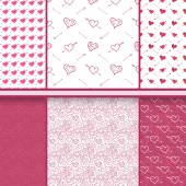 Hearts and arrows vector set of Valentine's Day red seamless patterns — Stock Vector