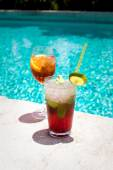 Glasses of Aperol Spritz and Mojito Royal cocktails — Stock Photo