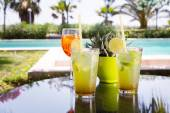 Two mojitoes with glass of Aperol Spritz at background — Stock Photo