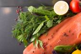 Salmon woth seasoning on a pan — Stock Photo