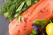 Salmon with seasoning on a pan — Stock Photo