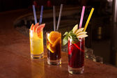 Cherry bomb, screwdriver and cuba libre cocktails in a tall glas — Stock Photo