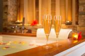 Two glasses of champagne near jacuzzi — Stock Photo