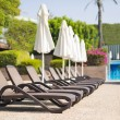 Sunbeds near a pool — Stock Photo #70524479