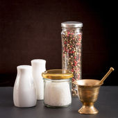 Concept of salt and pepper accessories — Stock Photo