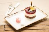 Cheesecake on a wooden background — Stock Photo