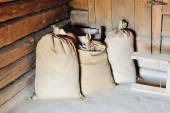 Bags of wheat grains — Stock Photo
